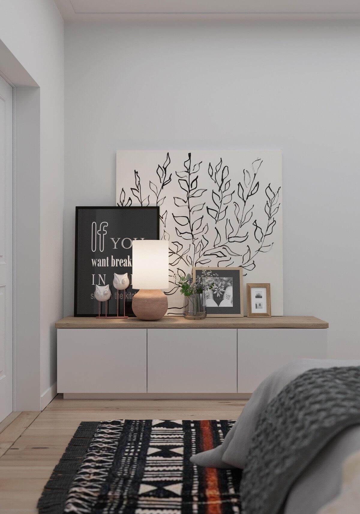 bedroom white shelf pictures art  - Mẫu căn hộ dưới 50m2 với không gian rộng rãi và cá tính