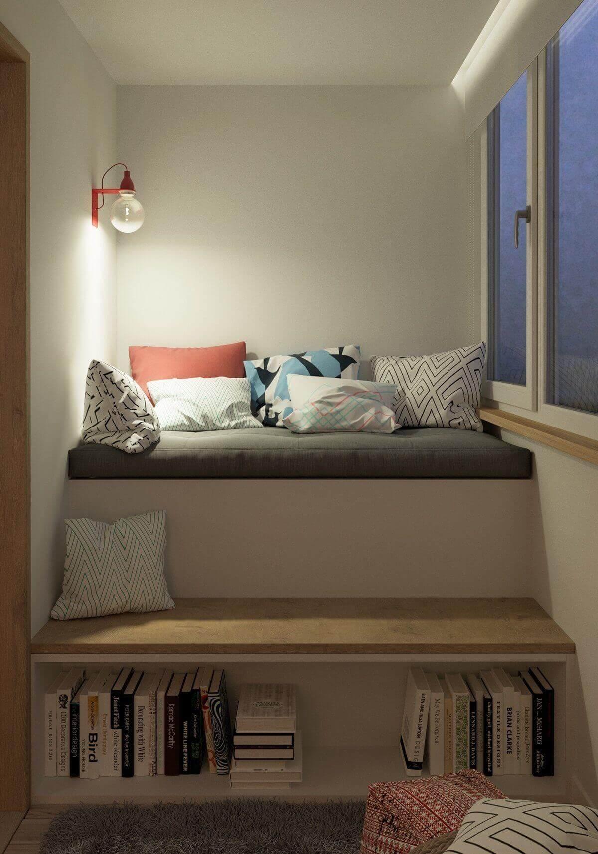 built in bookshelf cushions steps - Mẫu căn hộ dưới 50m2 với không gian rộng rãi và cá tính