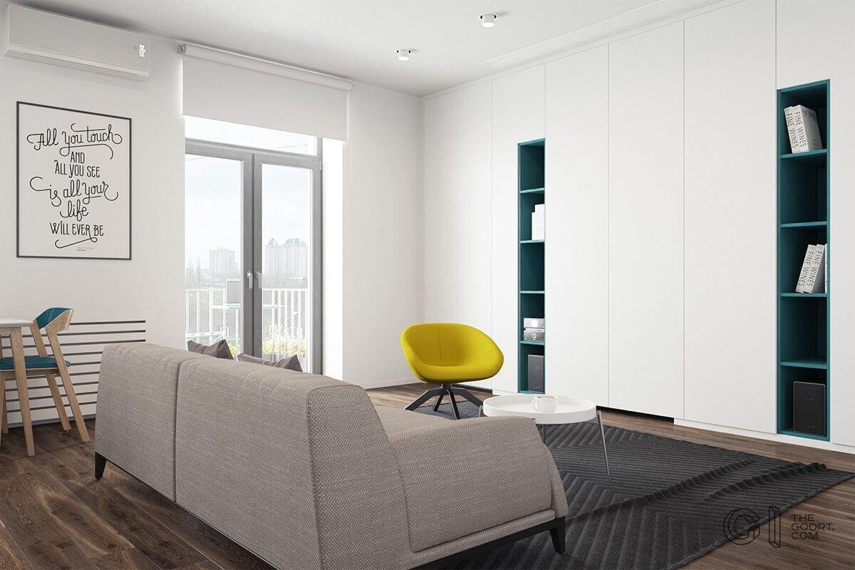 living room teal bookshelves yellow chair - Mẫu căn hộ dưới 50m2 với không gian rộng rãi và cá tính
