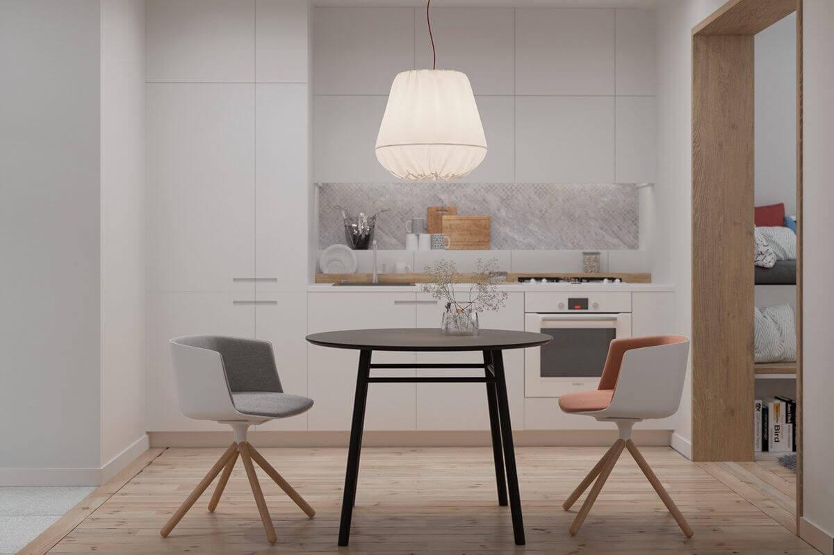 white kitchen tiny table chairs kitchen - Mẫu căn hộ dưới 50m2 với không gian rộng rãi và cá tính