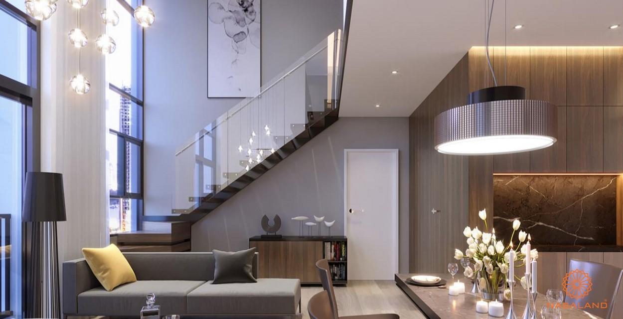 Nhà mẫu cầu thang lên tầng 2 cùng ghế salon phòng khách